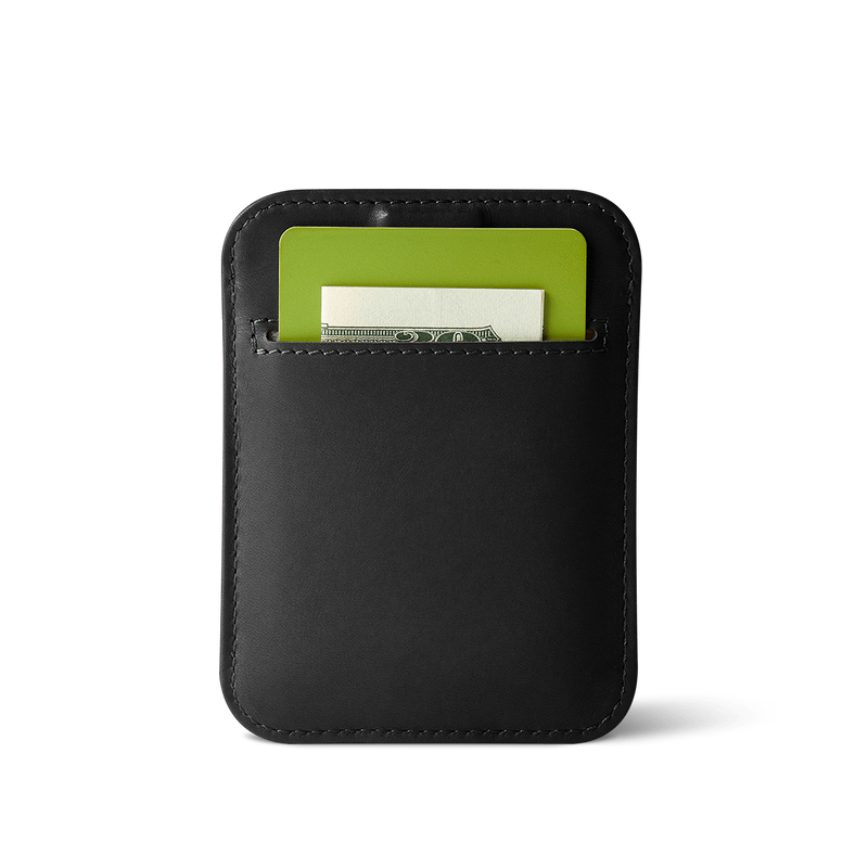 back view of slim wally sleeve black leather wallet with pocket carrying a card and folded bill