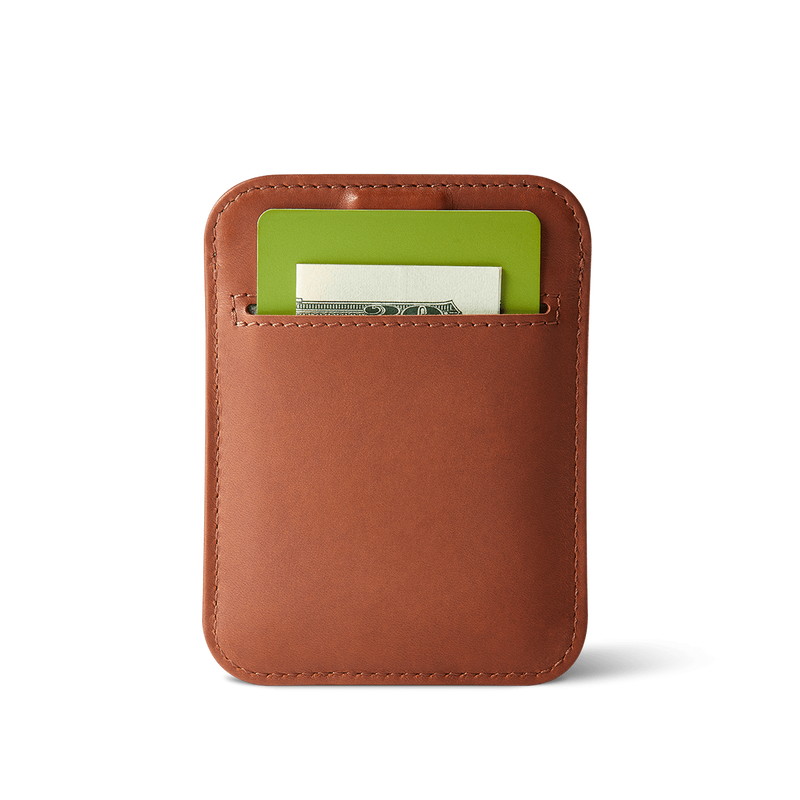 back view of slim wally sleeve brown leather wallet with pocket carrying a card and folded bill