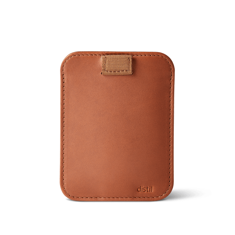 distil wally sleeve in brown leather with retractable pull tab and distil logo on bottom right