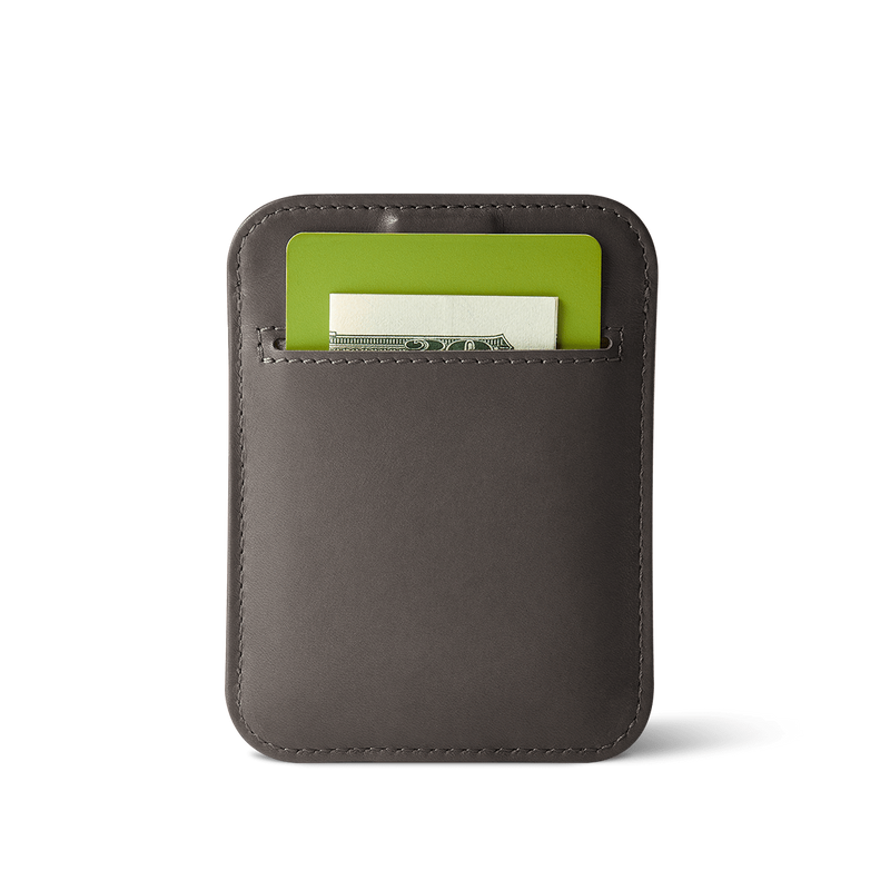 back view of slim wally sleeve gray leather wallet with pocket carrying a card and folded bill