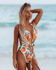 Wrap around swimsuit with vibrant print and a sexy open back for the beach