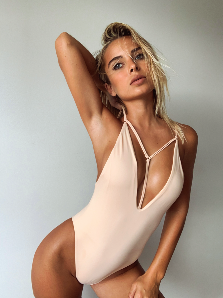 one piece swimsuit with strap detail and deep v neckline in a beautiful neutral color