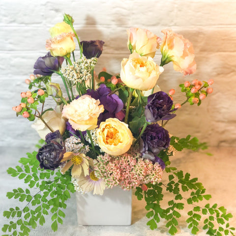 grand size, assortment of roses, tulips, hydrangea and greenery in glass or white vase