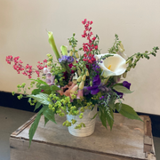 Bright pink, purple and white flowers with greenery in white vintage vase