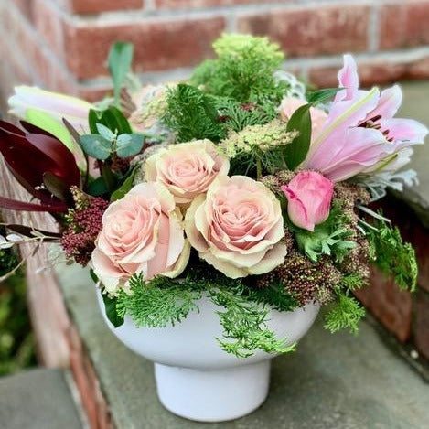 soft pink roses and lilies with greenery in white ceramic vase