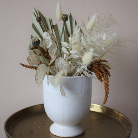 fall dried modern flowers and foliage in sleek modern vase