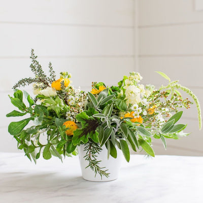 Cheerful white and yellow blooms and herbs, fragrant and whimsical