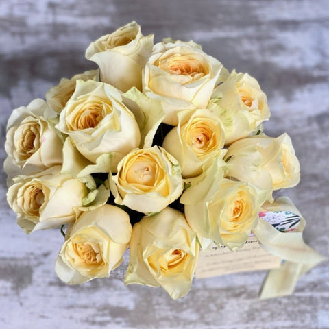 only yellow roses in white ceramic vase