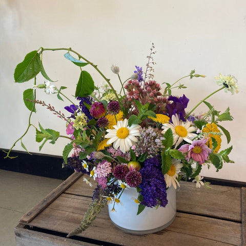 spring mixture of flowers in different colors in ceramic vase