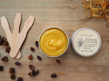 Natural, handmade whipped lip balm with sea buckthorn oil and calendula infused oil. With orange scent.