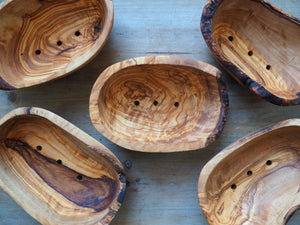 All natural, handmade soap dishes from olive wood. In a bowl shape with three holes on the bottom for draining the water.