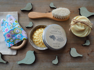 Gift set for new mum and baby with natural soap, lotion bar, baby brush and baby teether.