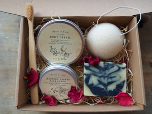 Gift set with natural face scrub, body cream, natural soap, konjac sponge and bamboo toothbrush.
