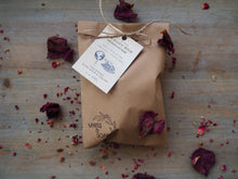 Our Daily Milk natural, handmade soap with cocoa butter and organic coconut milk. Pictured in its eco friendly, paper bag