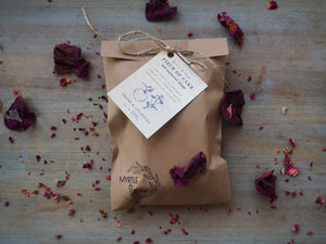 Piece of Cake natural, handmade soap with orange, chamomile and poppy seeds. In its eco friendly, paper bag.