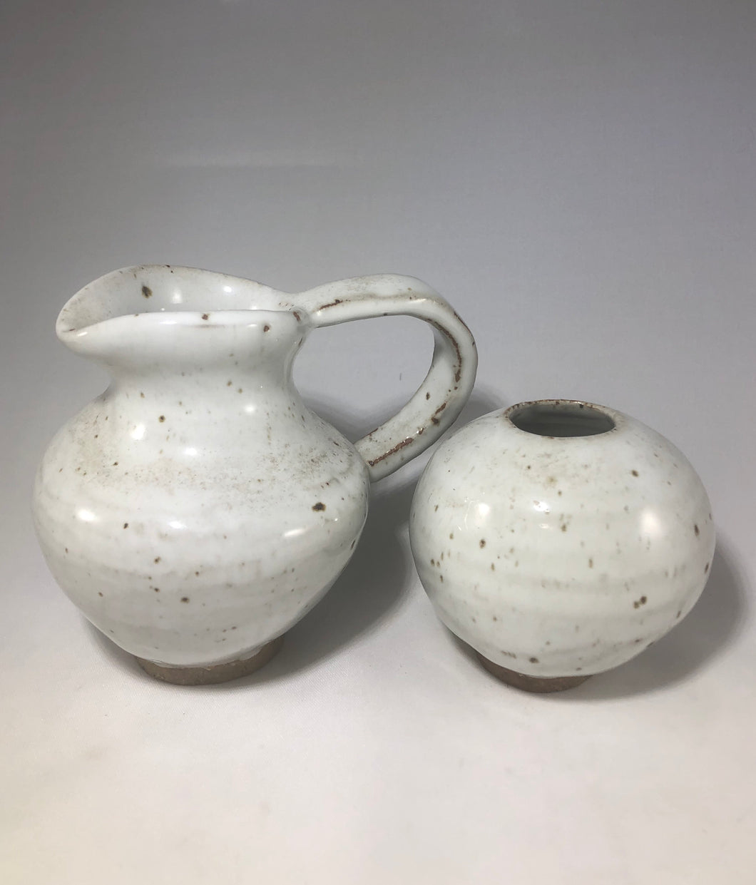 White pitcher and vase