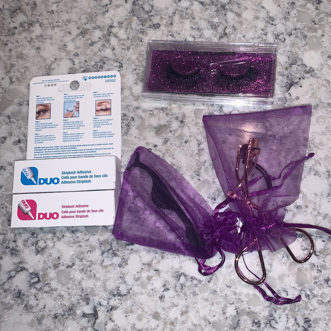 Bundle of lashes, glue, tweezers, and curler
