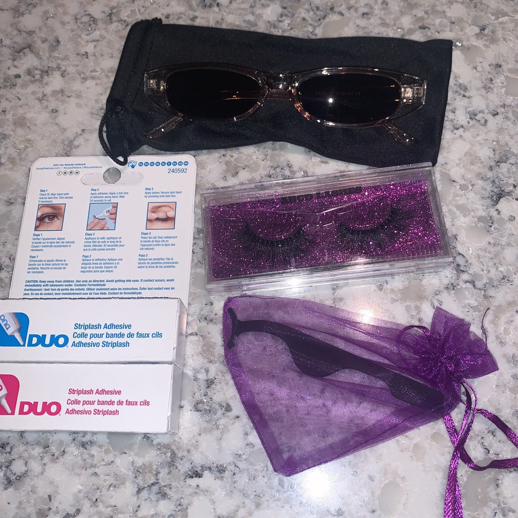Bundle of glasses, glue, lashes, and tweezer