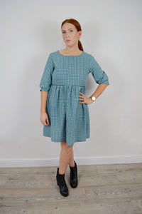 Nursing dress in a green and white check and long sleeves. Smock dress with invisible zips to allow breastfeeding. Ethical fashion made in the UK.