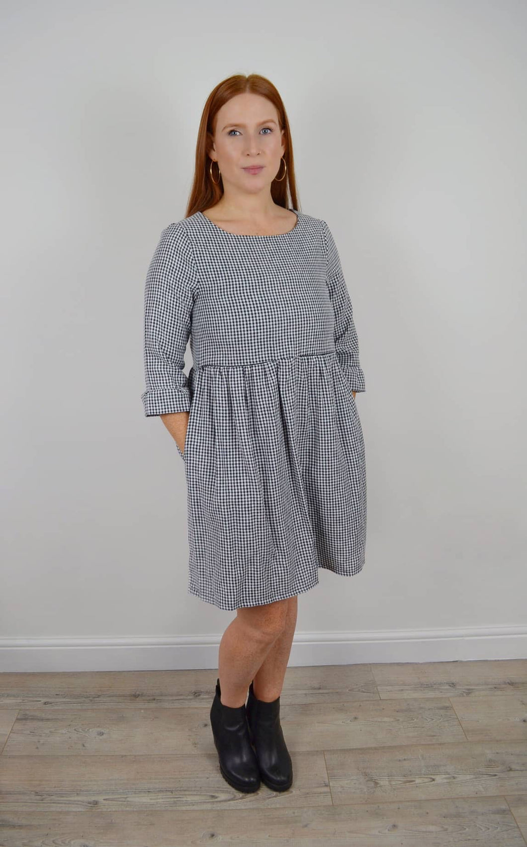 Gingham check nursing dress for breastfeeding Smock dress with flared sleeves and pockets Invisible zips allow breastfeeding Made ethically in the UK
