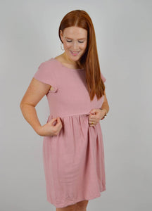 Pink linen nursing dress with pockets designed for breastfeeding. Smock dress with two invisible zips for nursing access. Ethical fashion made in the UK.