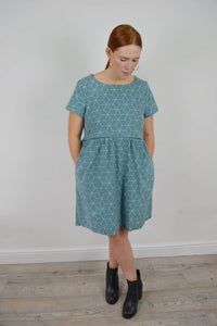 Nursing dress made in a green cotton with geometric print Smock dress with pockets and invisible zips to allow breastfeeding Ethical fashion