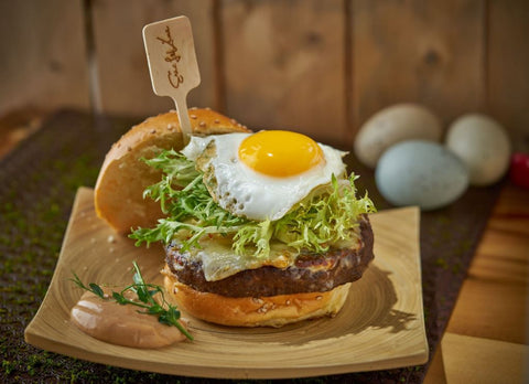 delicious burger with a custom logo skewer