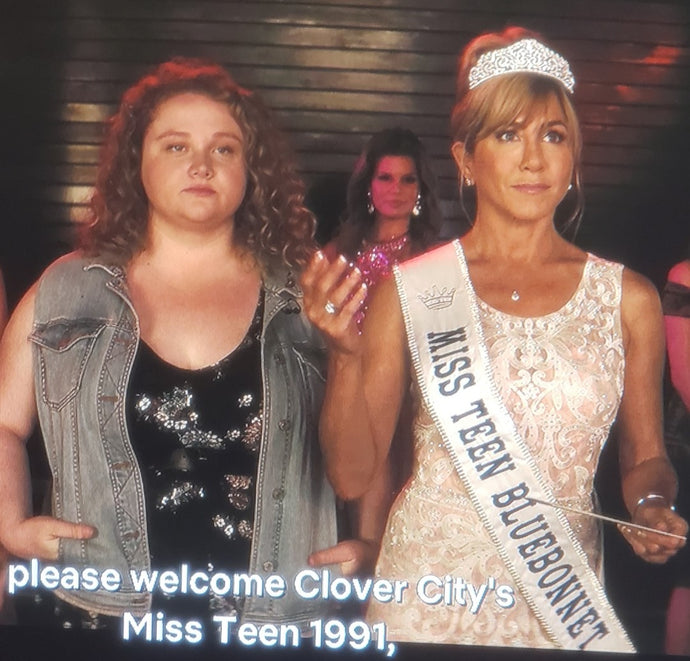 Sash worn by Jennifer Aniston in the Netflix movie DUMPLIN' made by Customsashes.com