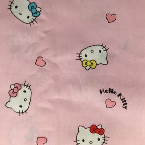 Hello Kitty heads on pink