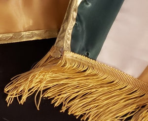Fringe on ends of sash
