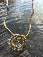 gun-metal-gold-snake-necklace