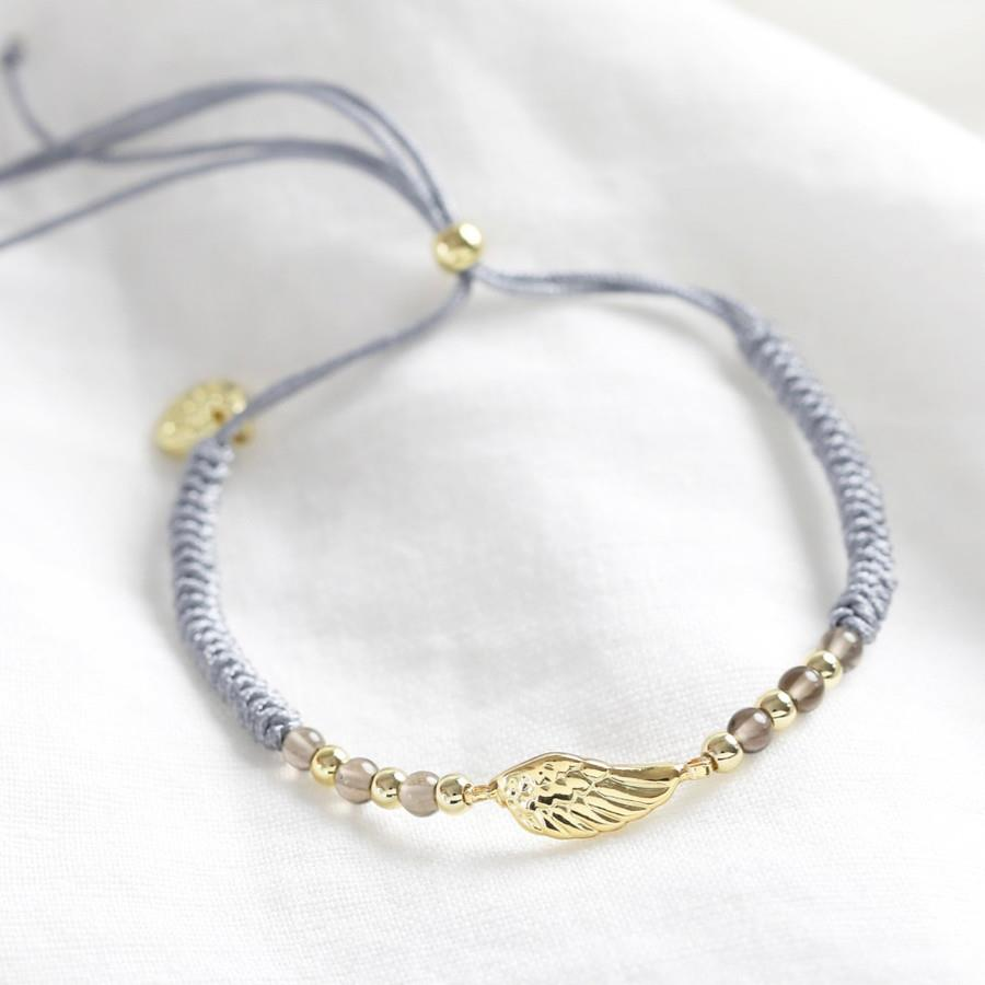 Gold Wing and Grey Cord Bracelet