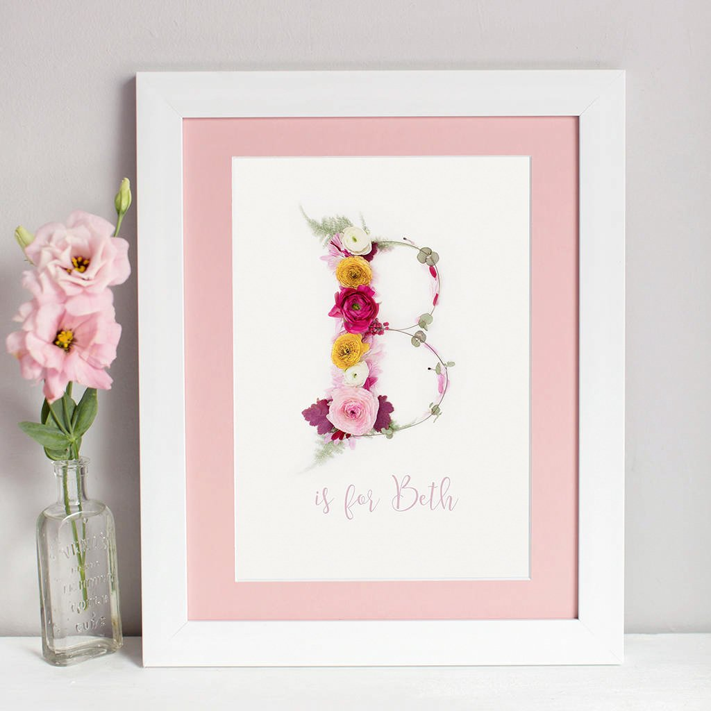 personalised name print created using a handmade floral alphabet