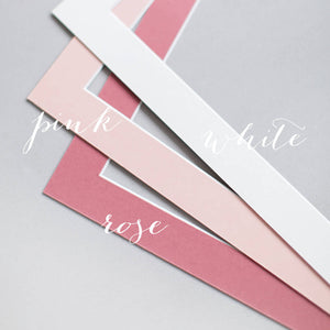 examples of three colours of bevel-cut winow mounts, white, pink and rose