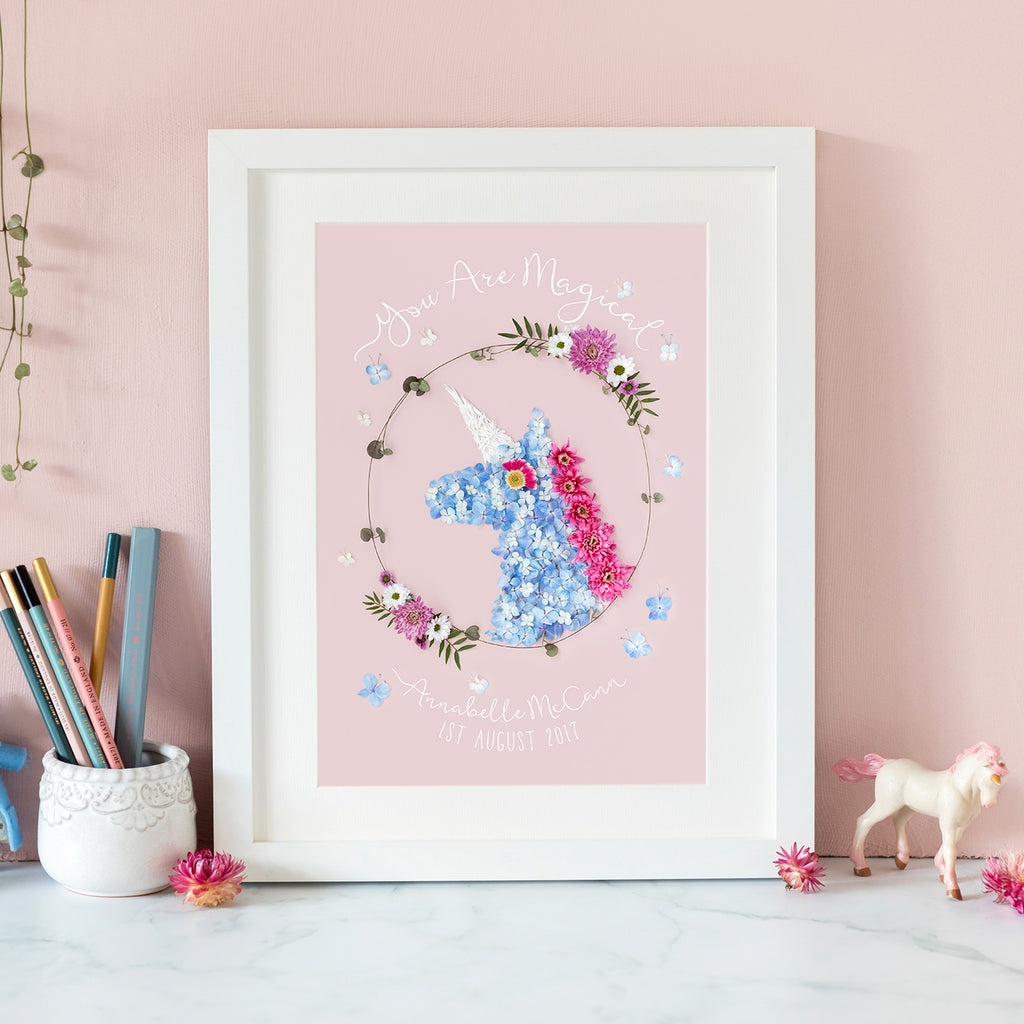 personalised unicorn print with floral design, made by photographing colourful flowers and petals on a pink background