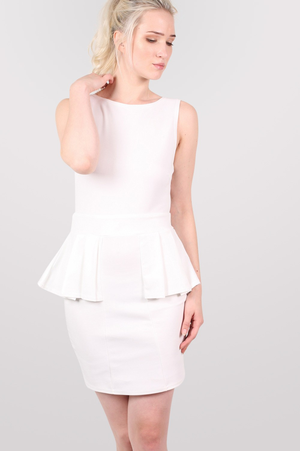 Low Back Peplum Dress in White MODEL FRONT