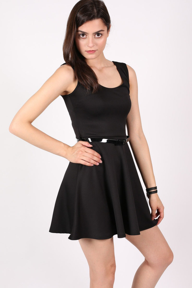 Sleeveless Belted Skater Dress in Black MODEL FRONT