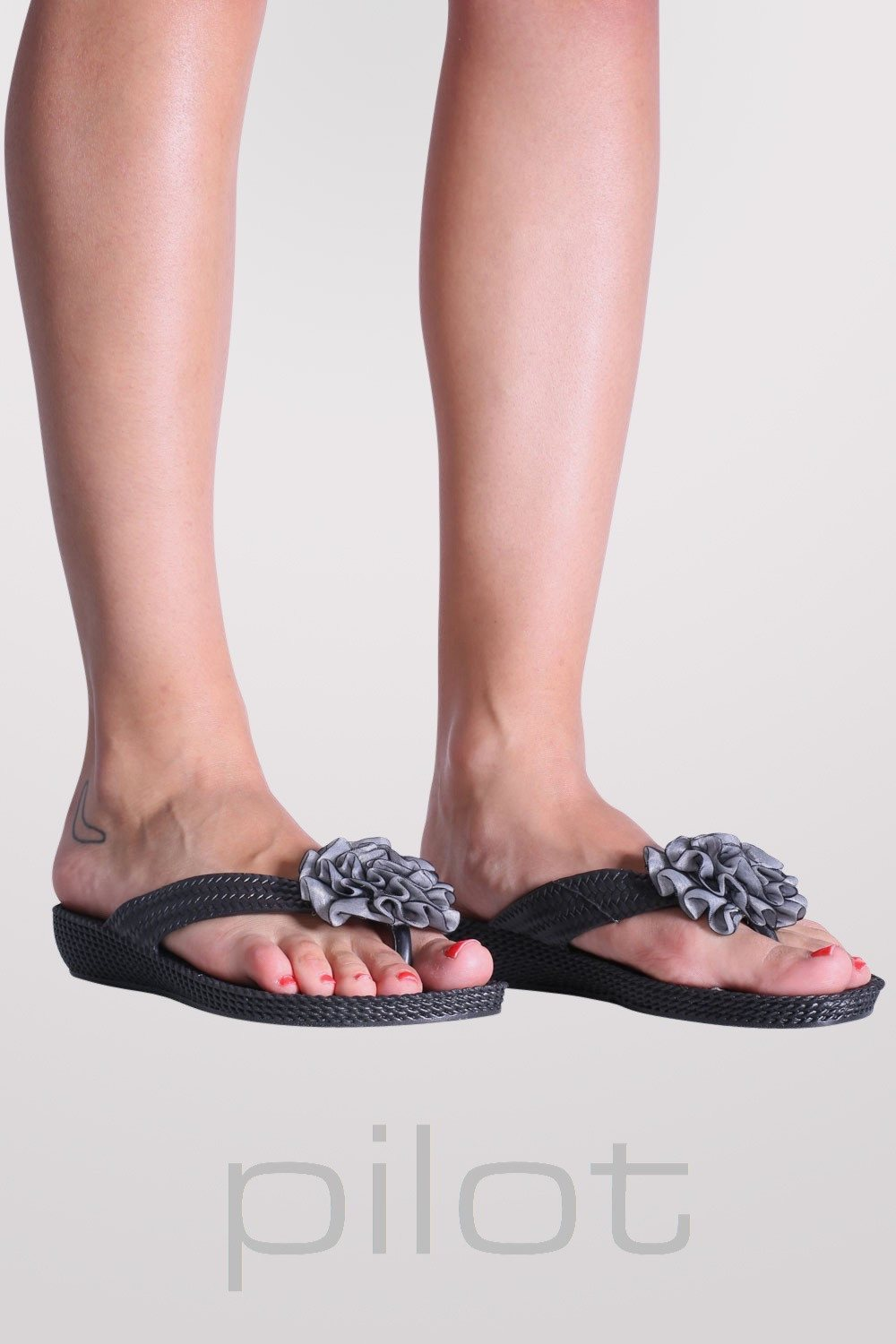 Large Flower Trim Flip Flops in Black MODEL FRONT