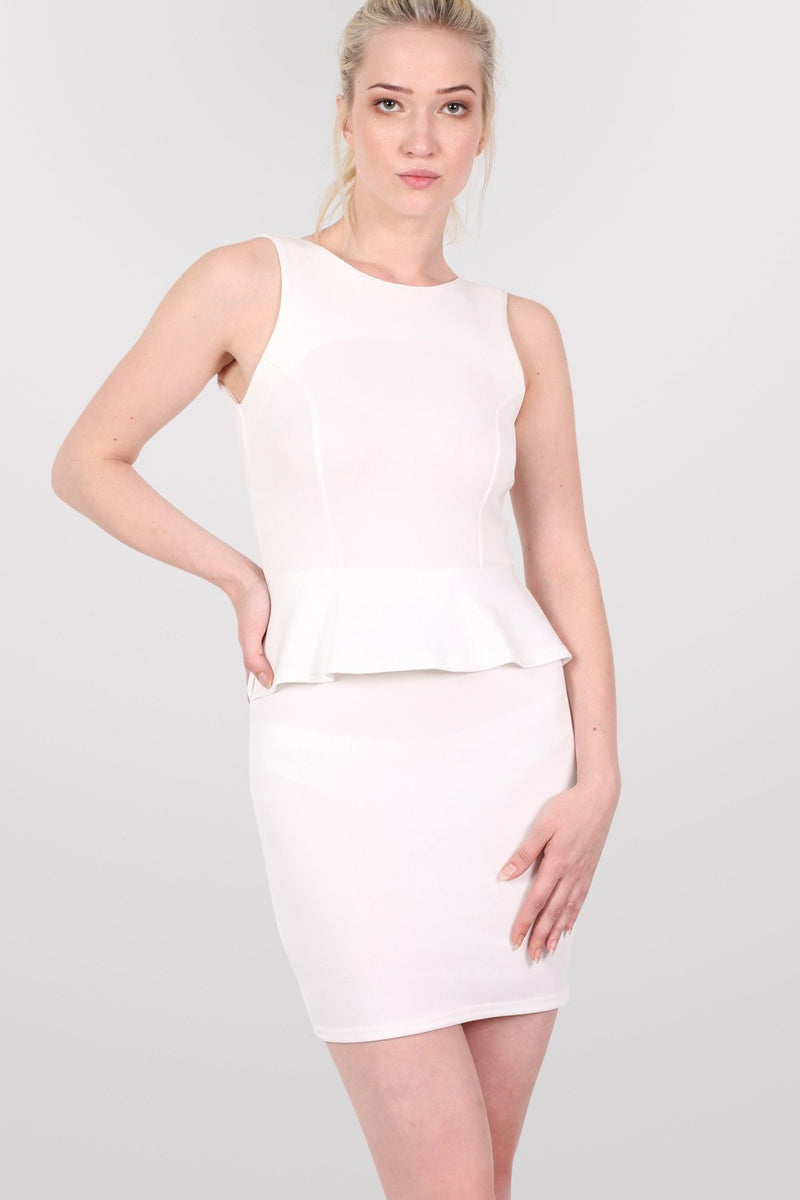 Sleeveless Peplum Dress in White MODEL FRONT