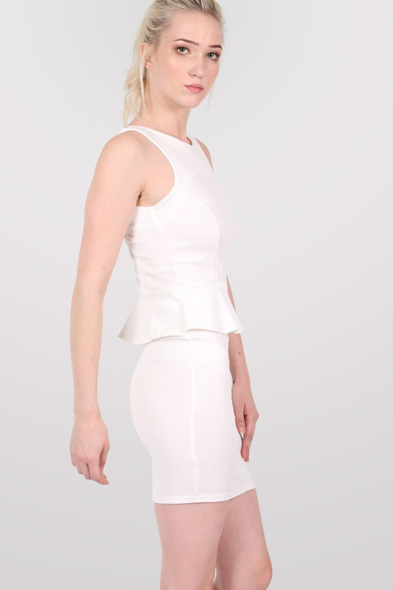 Sleeveless Peplum Dress in White MODEL SIDE