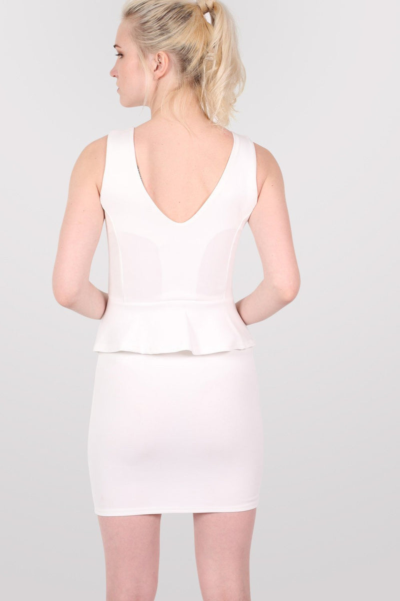 Sleeveless Peplum Dress in White MODEL BACK