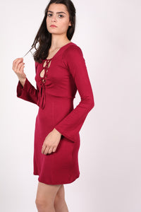 Bell Sleeve Lace Up Front Fit Flare Dress in Wine Red MODEL SIDE