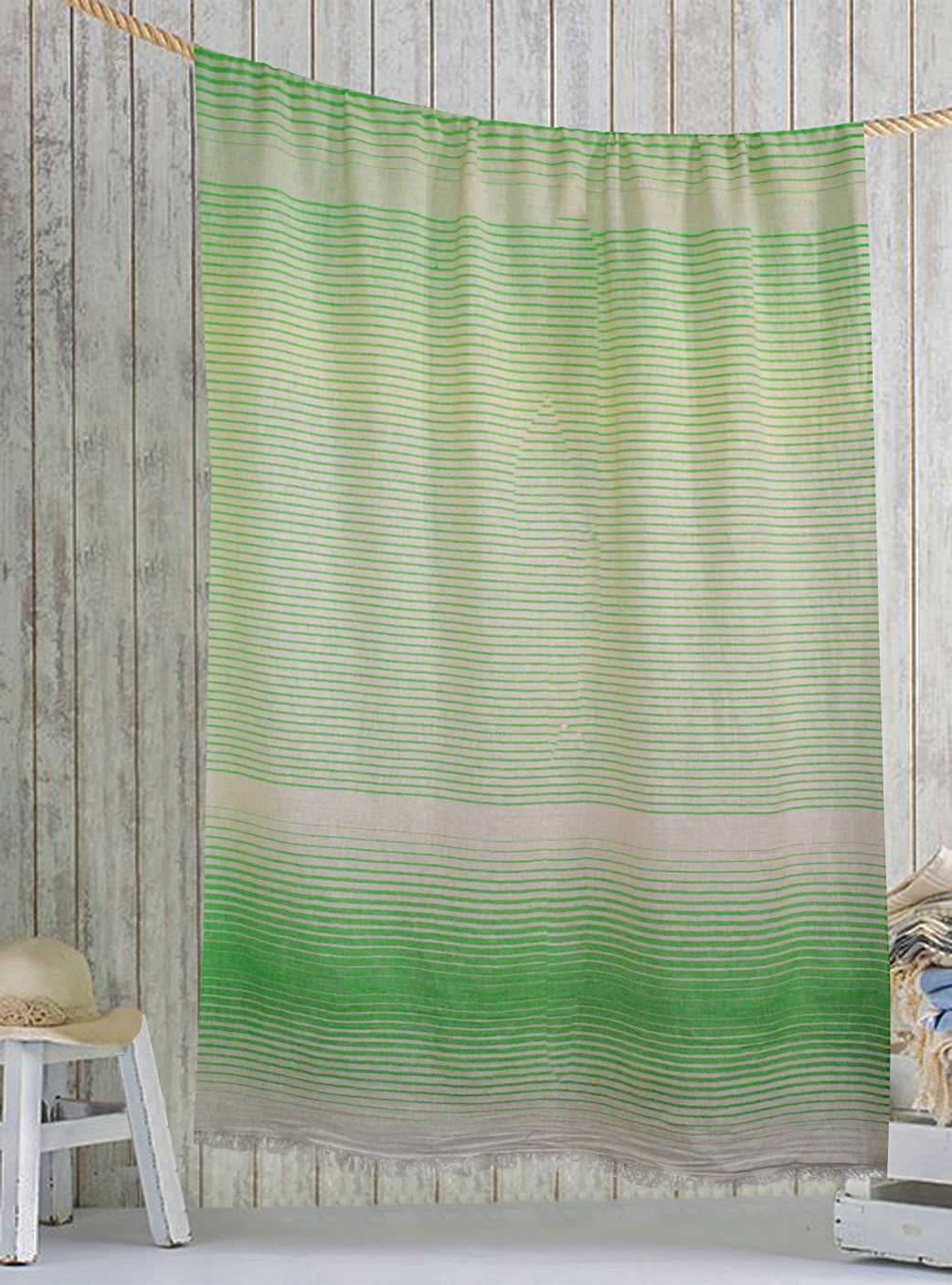 Green/White Turkish fouta towel, Lightweight, pure cotton, highly absorbent, quick-drying feature, multiple white stripes on it and is adorned with fringes on both ends.