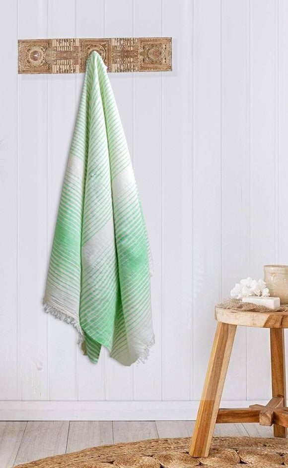 Turkish Bath towel Green/White , Lightweight, pure cotton, highly absorbent, quick-drying feature, multiple white stripes on it and is adorned with fringes on both ends.