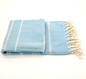 Turkish bath towel pale-blue denim , lightweight, loomed with pure cotton in yarn-dyed stripes and edged with hand-knotted fringes at both ends.
