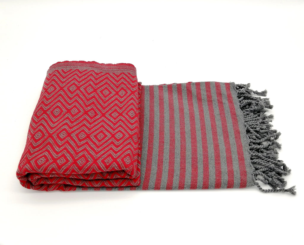 Turkish towel Sultan red, lightweight, loomed with pure cotton in yarn-dyed stripes and edged with hand-knotted fringes at both ends.