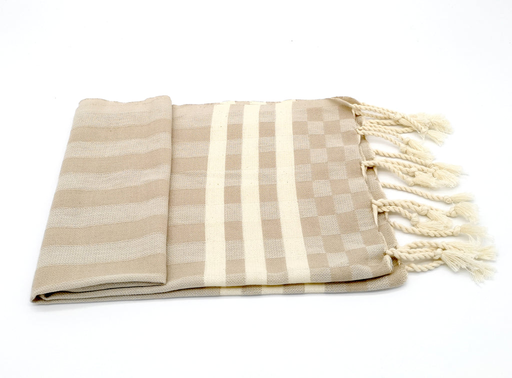 Turkish hand towel Beige, made from cotton, extra folding, loose fringes at both ends with stripes pattern.