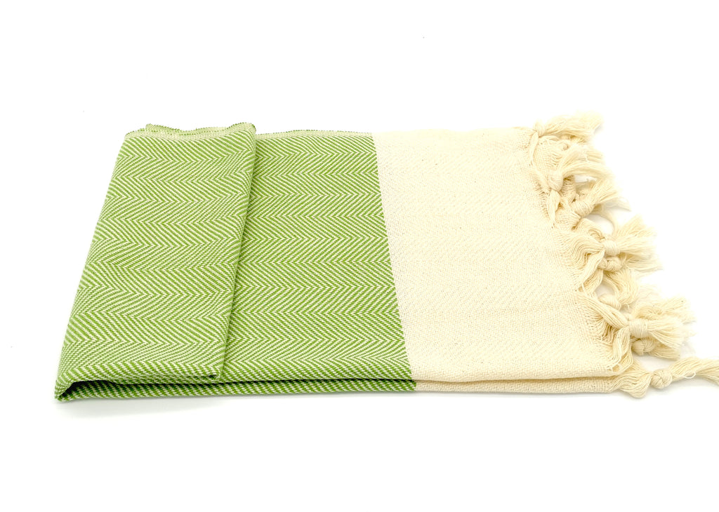 Turkish hand towel green, made from cotton, extra folding, loose fringes at both ends with chevron pattern.