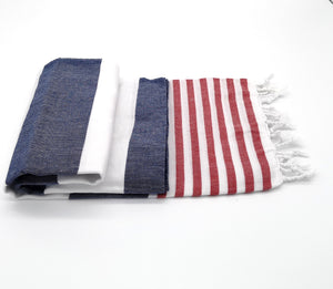 Turkish bath towel Navy/Red , made from cotton, with stripes pattern and loose fringes at both ends.