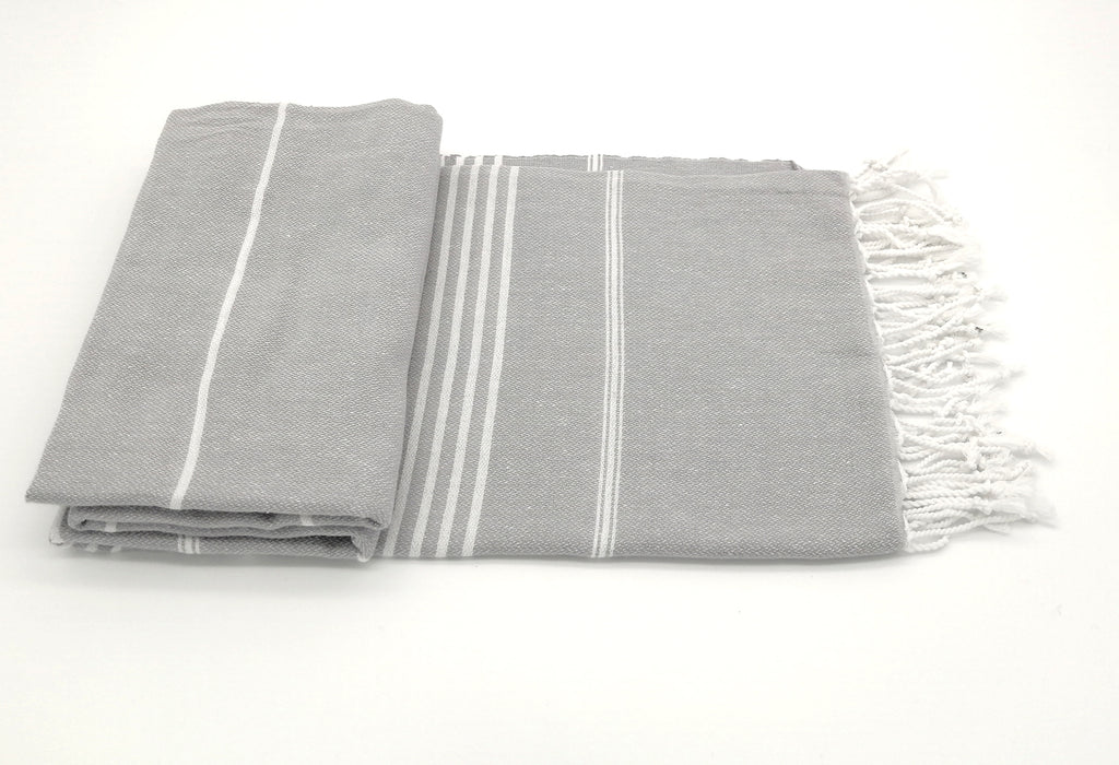 Turkish bath towel silver, lightweight, loomed with pure cotton in yarn-dyed stripes and edged with hand-knotted fringes at both ends.